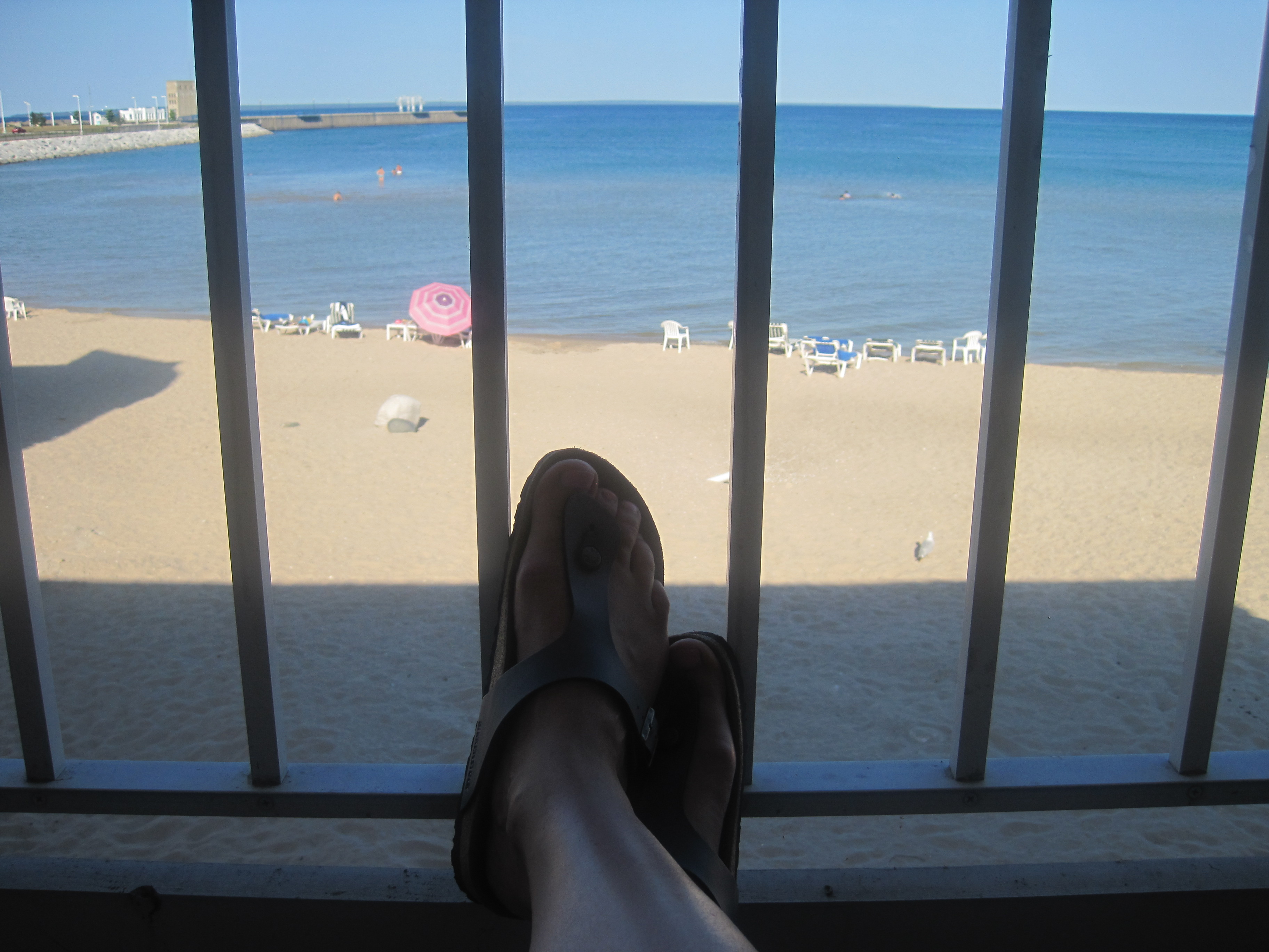 My feet, straining to be free of their Travelodge prison; Mackinaw City, MI, 2012